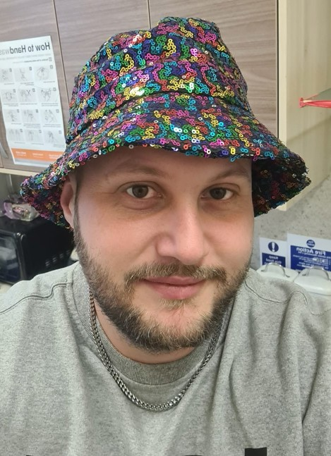 Senior Support Worker, Chris in his glam hat
